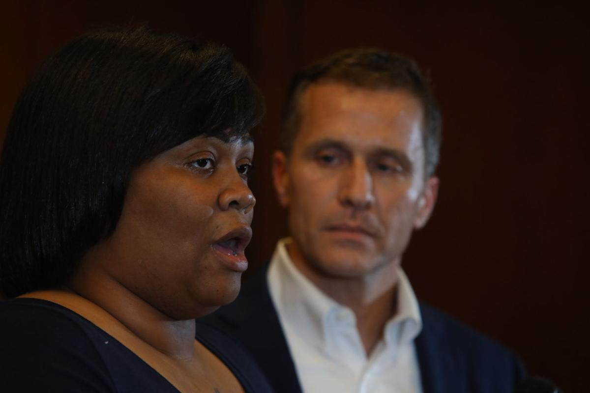 Governor Eric Greitens, right, and Christina Wilson, fiancée of Anthony Lamar Smith