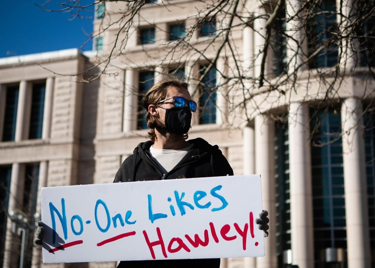Demonstrators demand Hawley's resignation at downtown protest