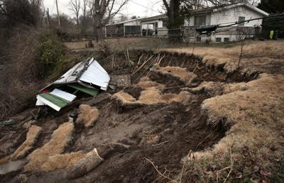 North County homes losing yards to creek