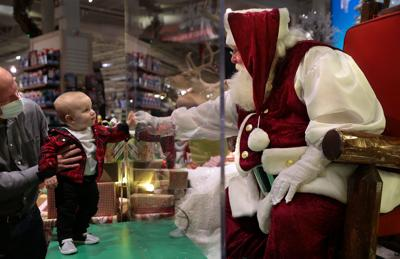 Sanitized Santa appears behind the glass