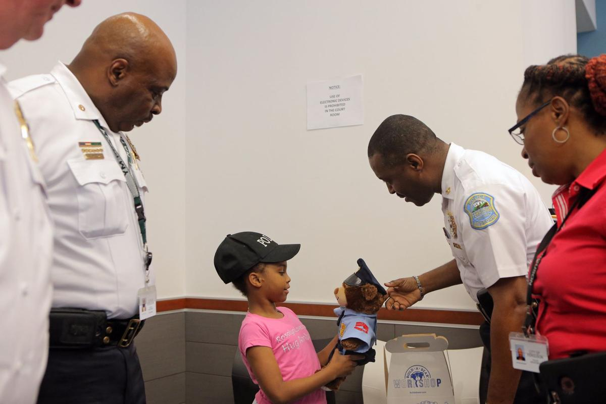 Girl on mission to hug a police officer in all 50 states stops by Ferguson Police Department