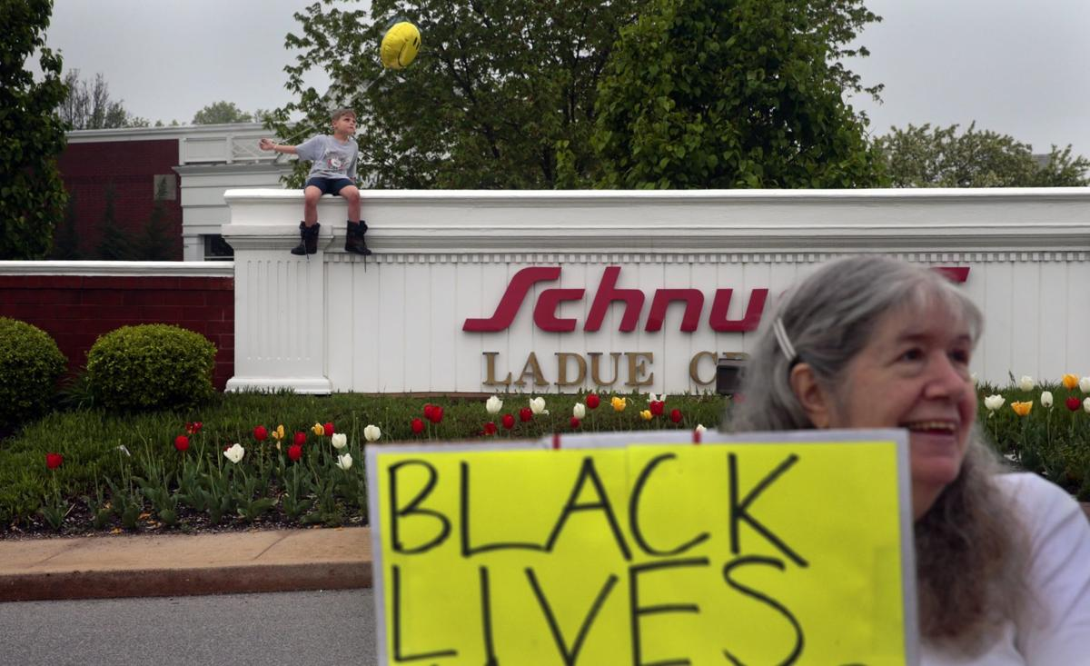 Ladue police shooting protest draws 30 people outside Schnucks