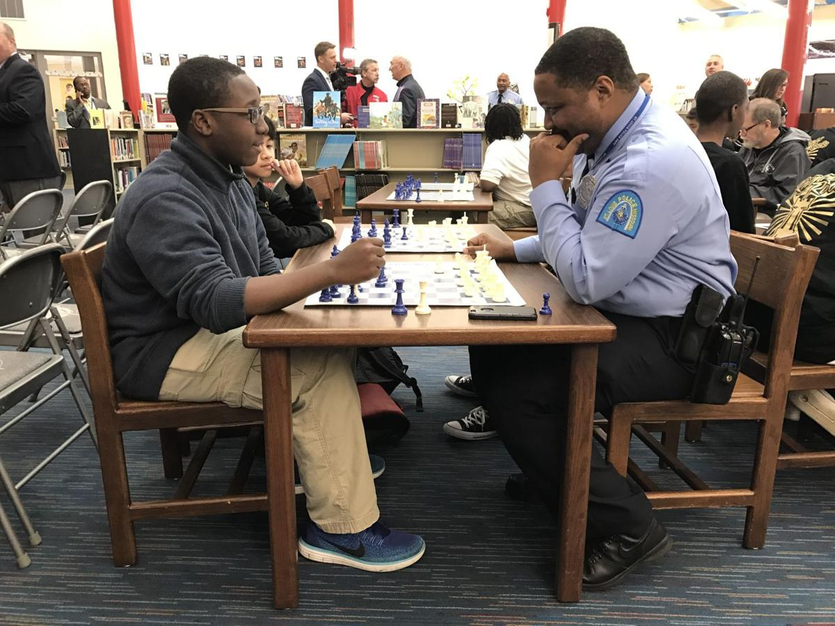 St. Louis police play chess with public school students