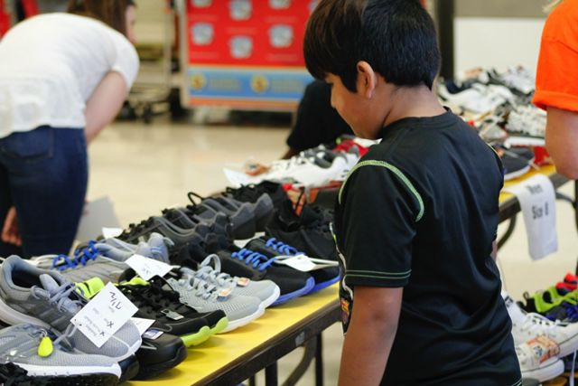 A young boy looking for a special pair of sneakers.JPG