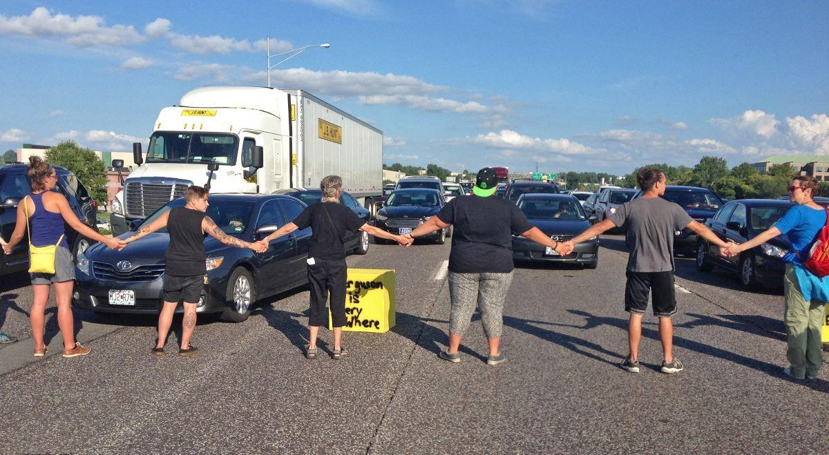 Ferguson protesters block rush-hour traffic on I-70 and get arrested