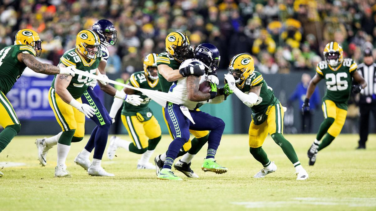 Seattle Seahawks running back Marshawn Lynch (24) is stopped by the Green Bay defense in the first quarter on Sunday, Jan. 12, 2020 at Lambeau Field in Green Bay, Wis.