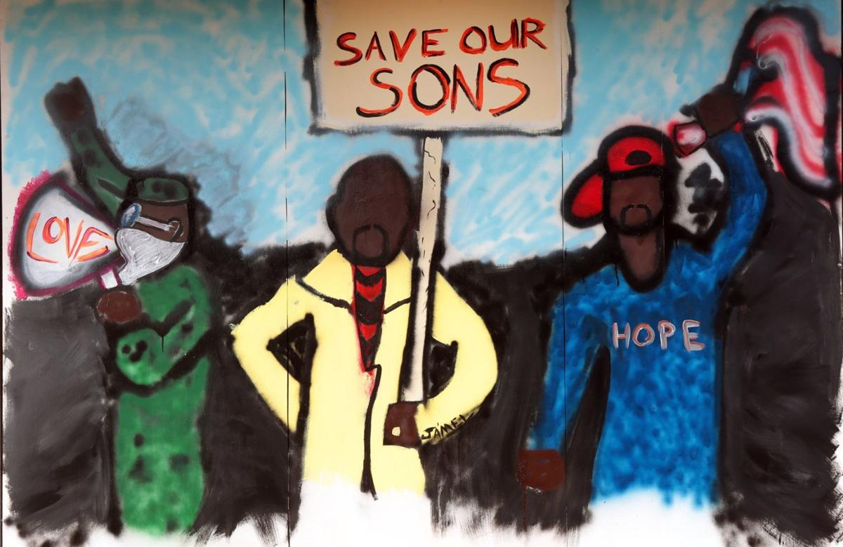 Plywood art protects, transforms Ferguson neighborhood