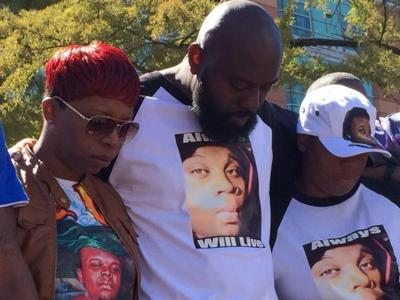 Michael Brown's relatives pause for 4.5 minutes of silence