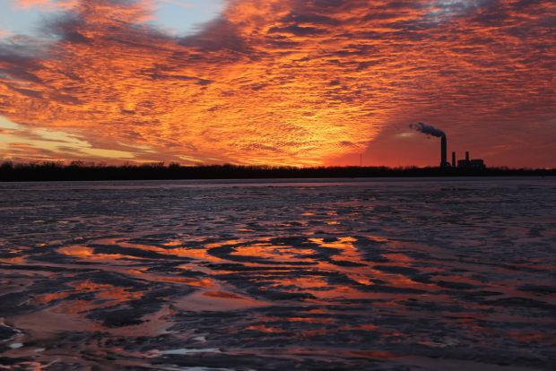 Sunset shows power plant near Portage des  Sioux