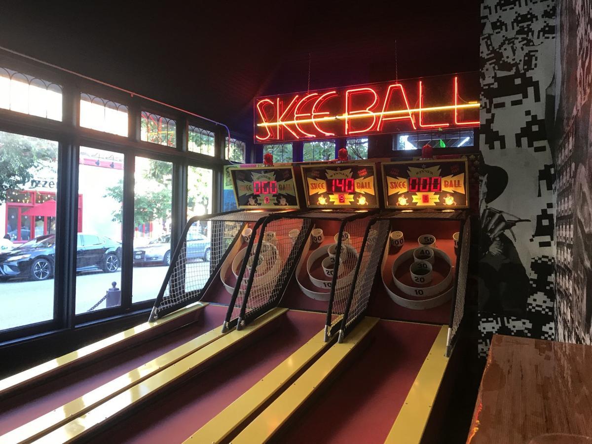 Skee ball at arcade bar
