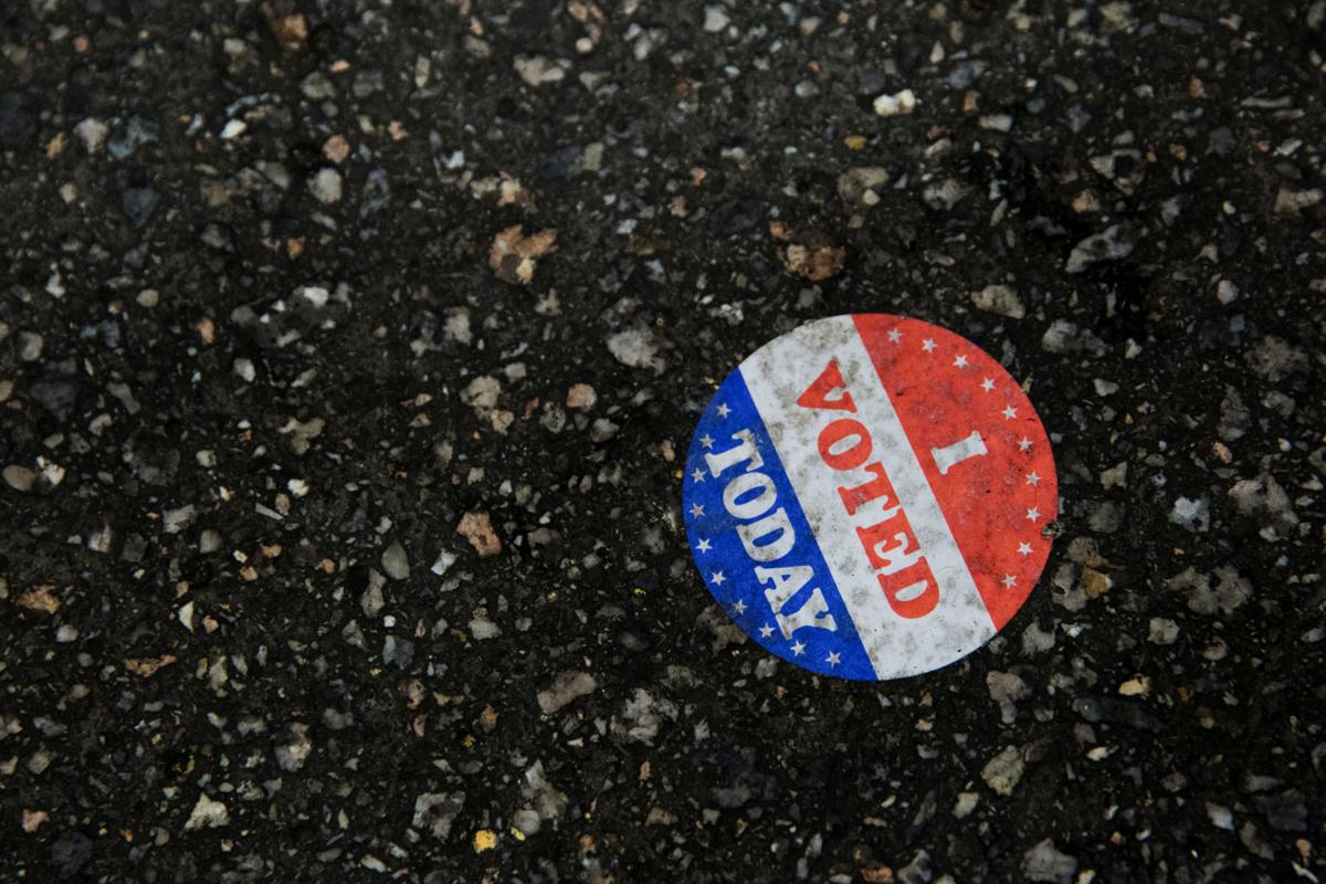 "An ""I voted today"" sticker is seen on the ground at Philadelphia's City Hall, an early voting location for the upcoming presidential election, in Philadelphia, Pennsylvania"
