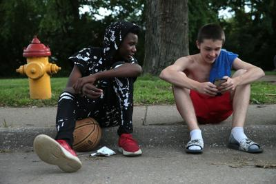 Younger Ferguson friends play and work together