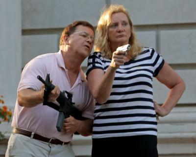 CWE couple display guns during protest