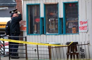 St. Louis αστυνομικός πυροβόλησε στο ένοπλες υπόπτων, η αστυνομία λέει