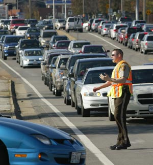 Police officer directs traffic on Manchester Road