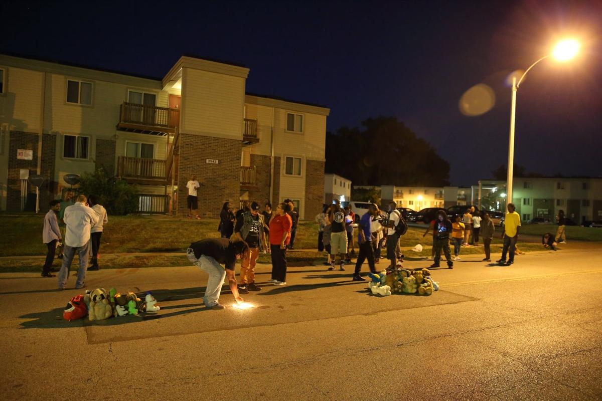 Ferguson residents, activists rebuild memorial to Michael Brown on ...