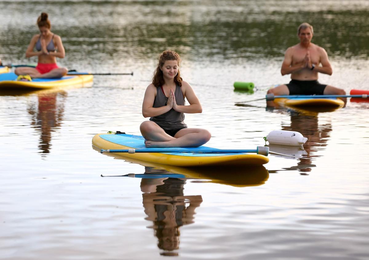 Paddleboard yoga at Creve Coeur Lake