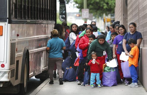 Messenger: St. Louis contingent digs in to help the huddled masses at a bus stop near the border