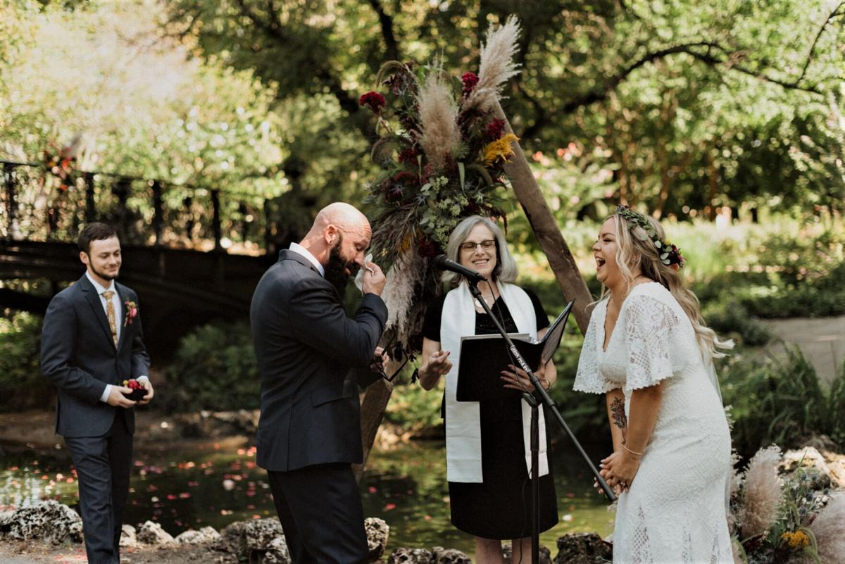 Rev Judi silver hair bride laughs groom cries.jpg