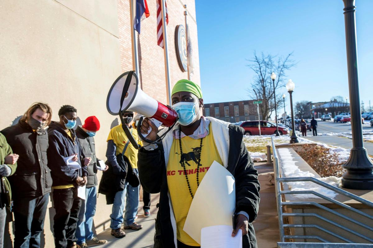 KC Tenants activists block the entrance to Eastern Jackson County Courthouse in Independence
