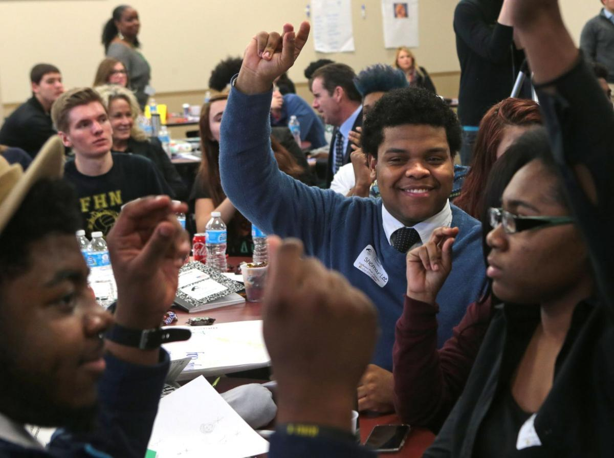 Students from local high schools meet for a summit on race