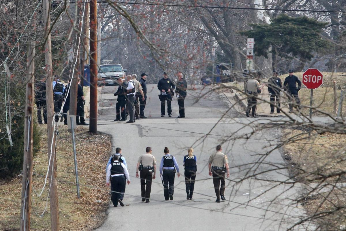 Police raid house in Ferguson looking for shooter