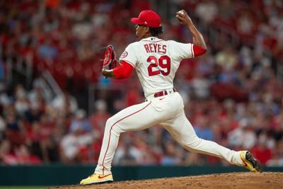 Cardinals take on Reds