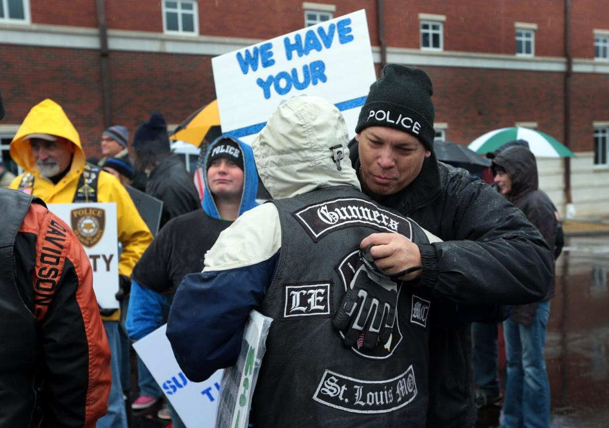 Police supporters, protesters, rally in Ferguson