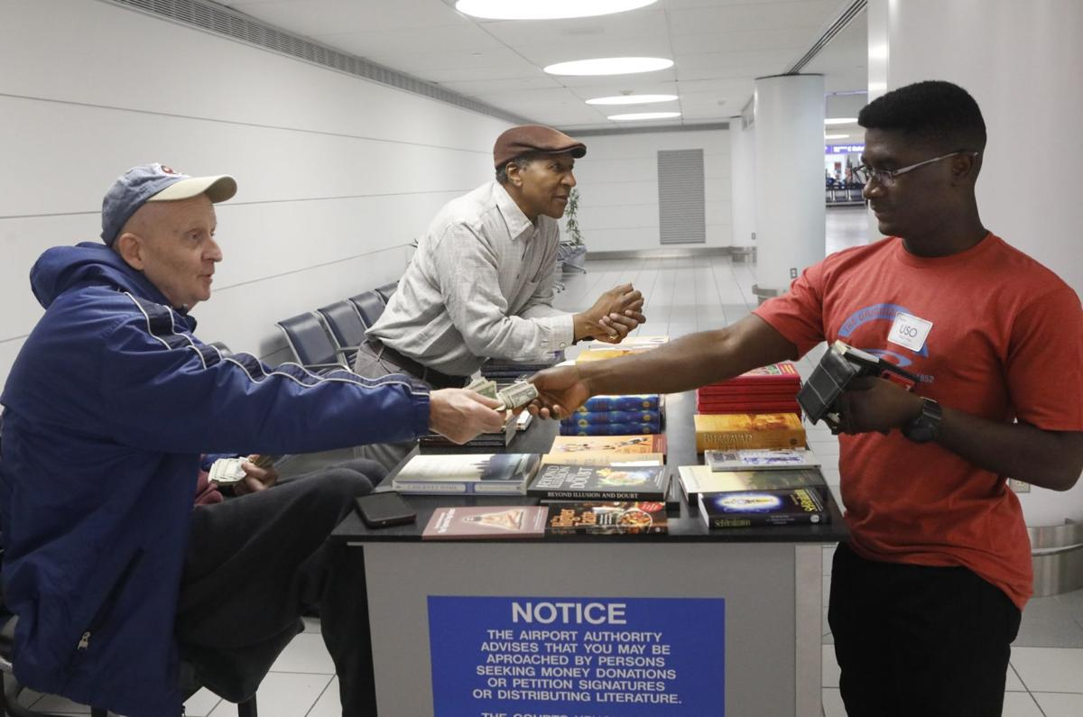 Passengers curious about Airport Free Speech Booths