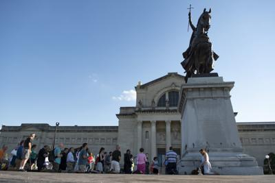 St. Louis Catholics gather for Rosary at King Louis IX statue
