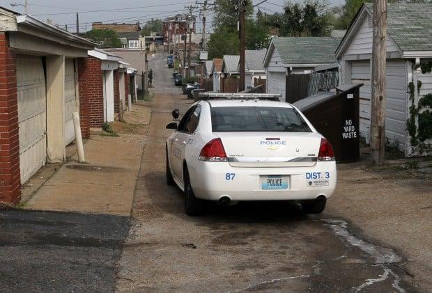 Police car cruises near scene of slaying