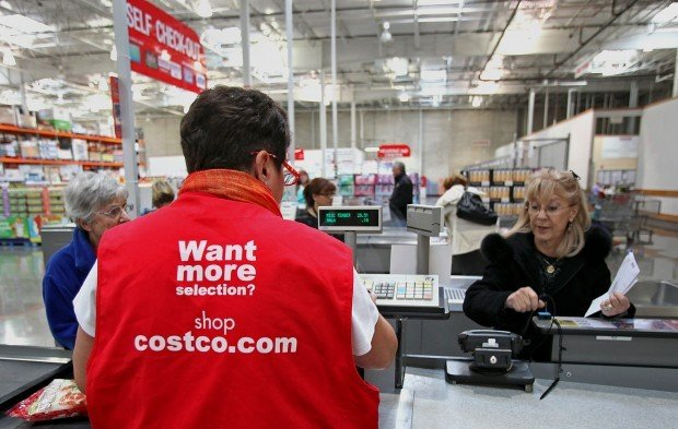 a sales associate helps a customer check out at a costco wholesale corp store in mount prospect ill on tuesday dec 4 2012
