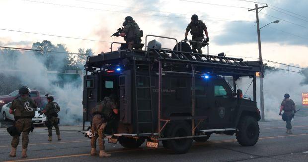 Tactical officers fire tear gas in Ferguson