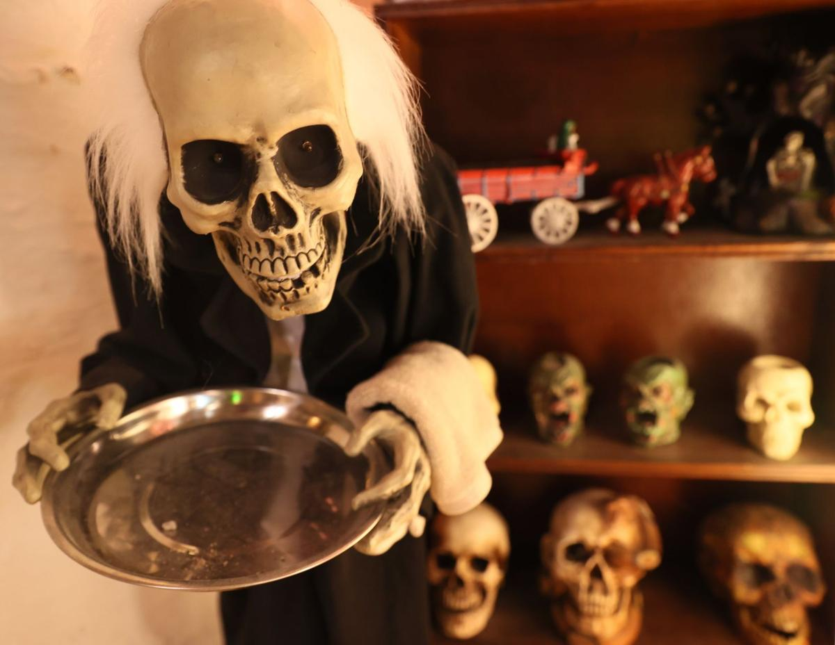 Halloween enthusiast keeps permanent themed display