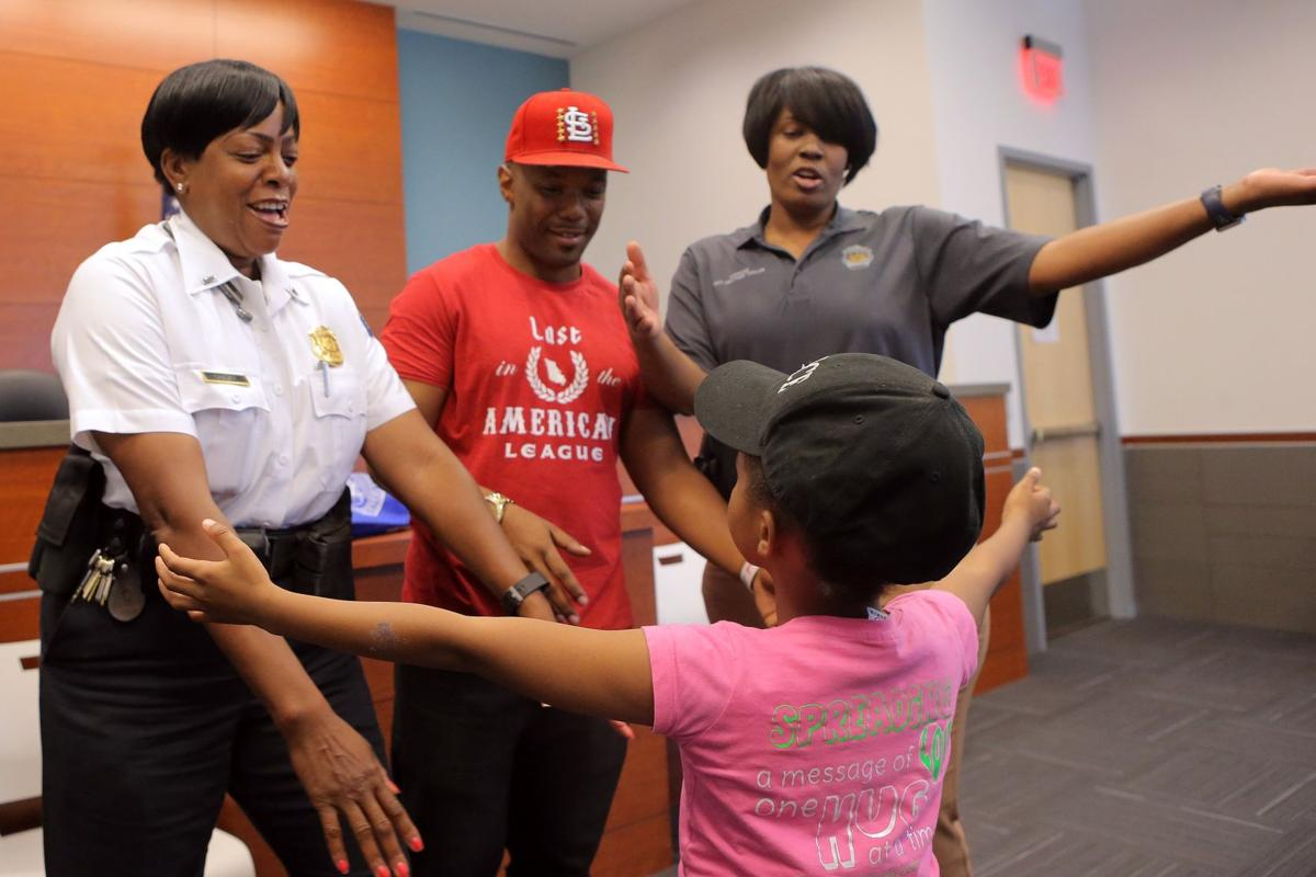 Girl on mission to hug a police officer in all 50 states stops by ferguson police