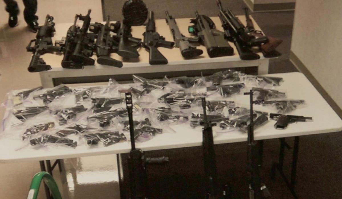 Seized guns and money
