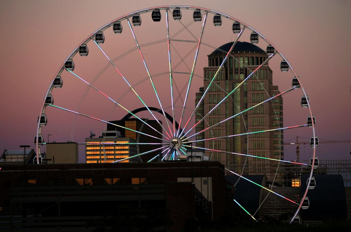 The St. Louis Wheel at Union Station lights up the sky
