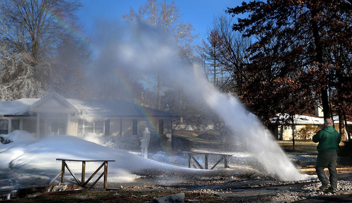 Water main break coats home in ice in Ladue