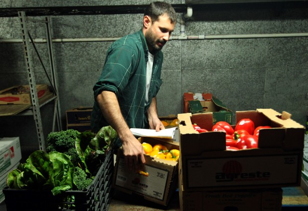 Farm to Family Naturally Mobile Market John Williams loads up produce-peppers