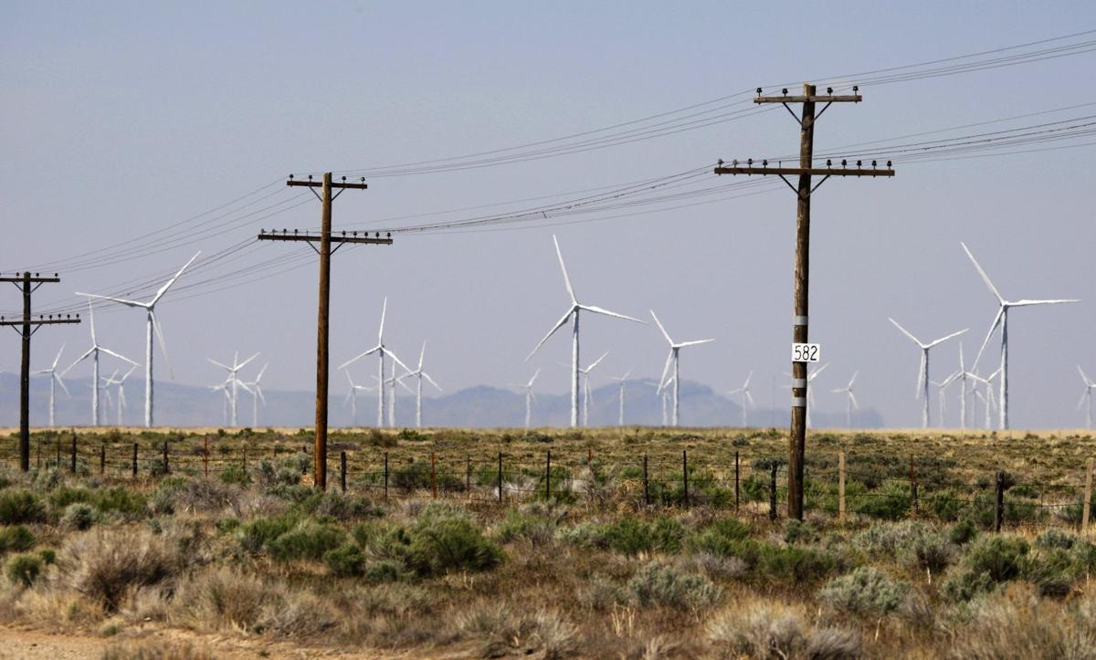 File photo of power lines run by wind turbines at a wind farm near Milford