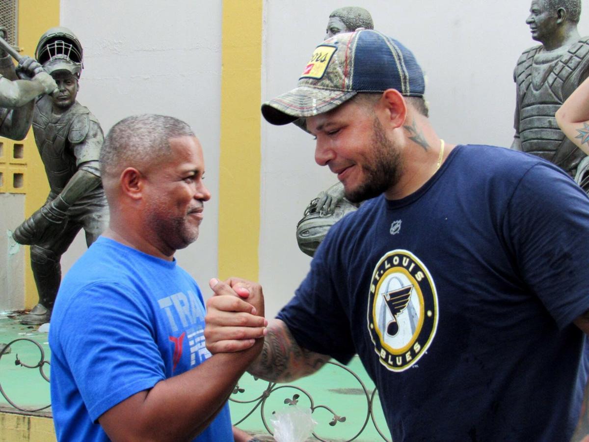 Molina greets neighbor in hometown Vega Alta, Puerto Rico