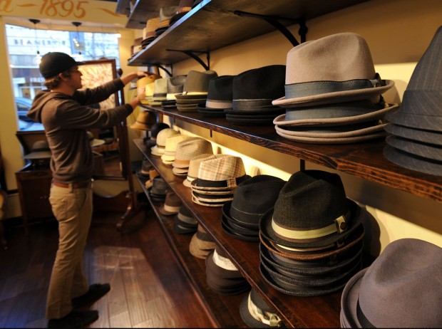 Assistant store manager Chris Brodell adjusts the merchandise at the Goorin  Bros. Hat Shop on College Avenue in Berkeley 3af81ce17f14