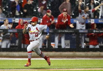 c91d4511 After Mets argue to play through the rain, Cardinals rally to tie ...