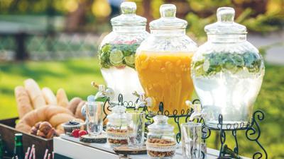 Glass jars of lemonade and decor on wedding candy bar