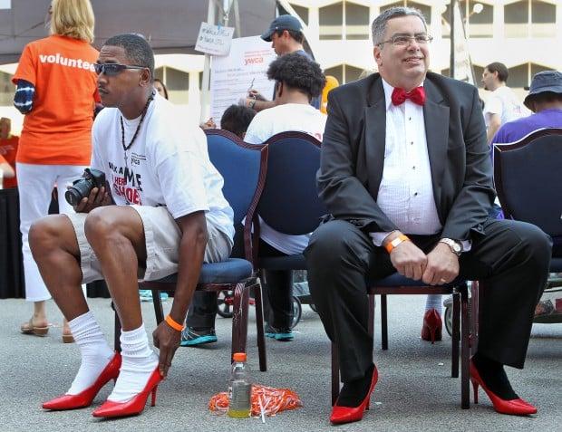 b6a3d62cbd13 Men walk in high heels to combat sexual assault of women