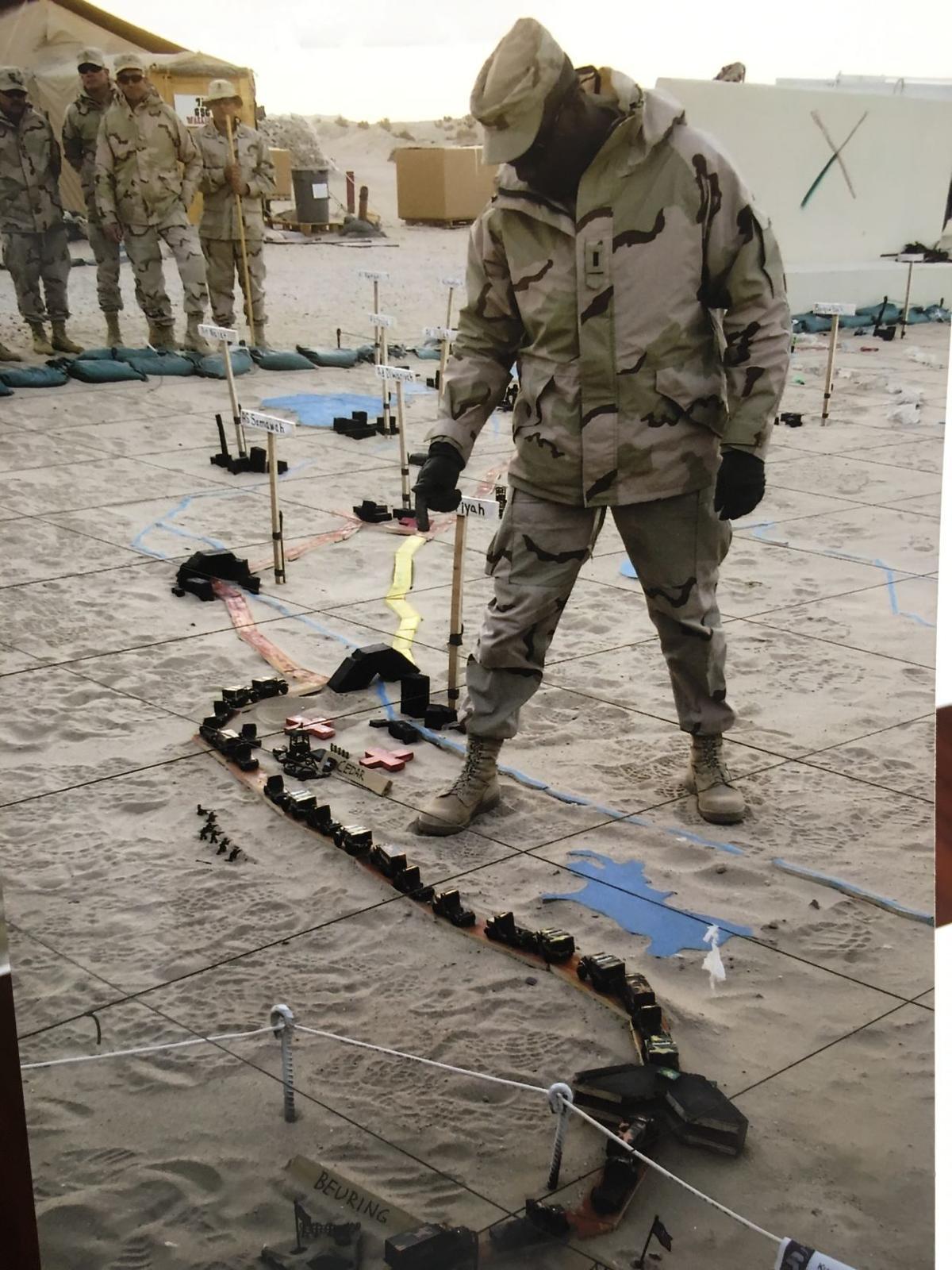 SOH Carpenter planning convoy into Iraq.JPG