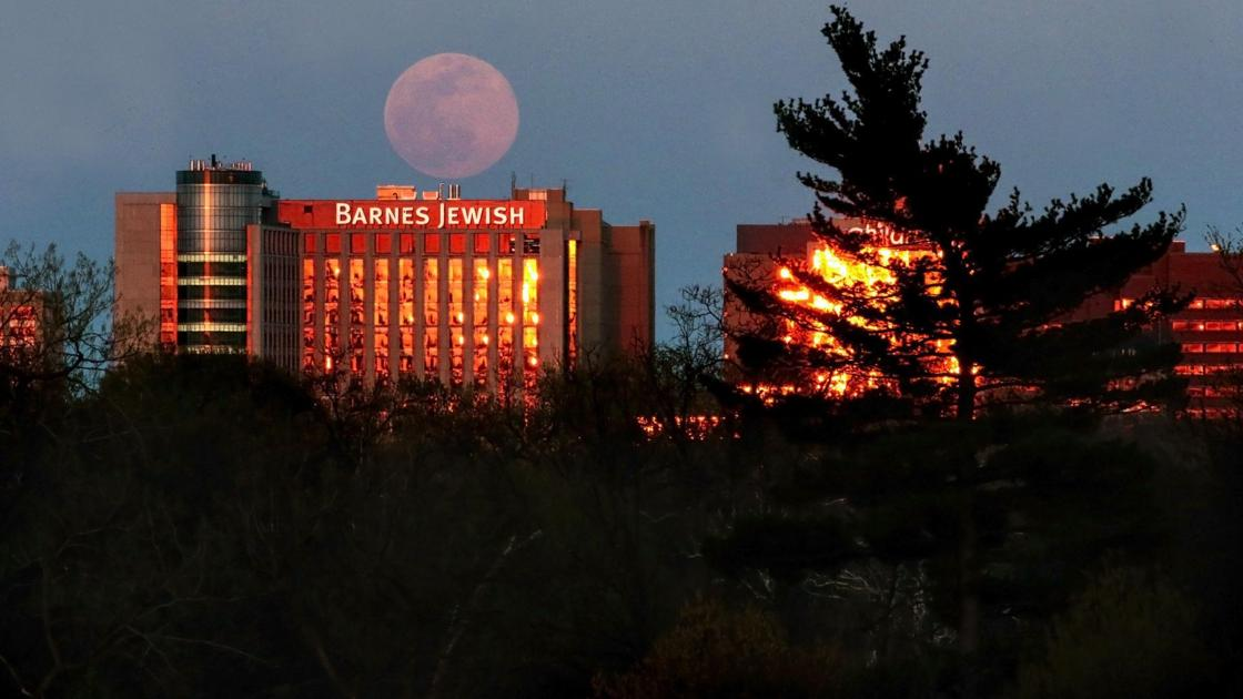 Photos: A supermoon rises during the pandemic