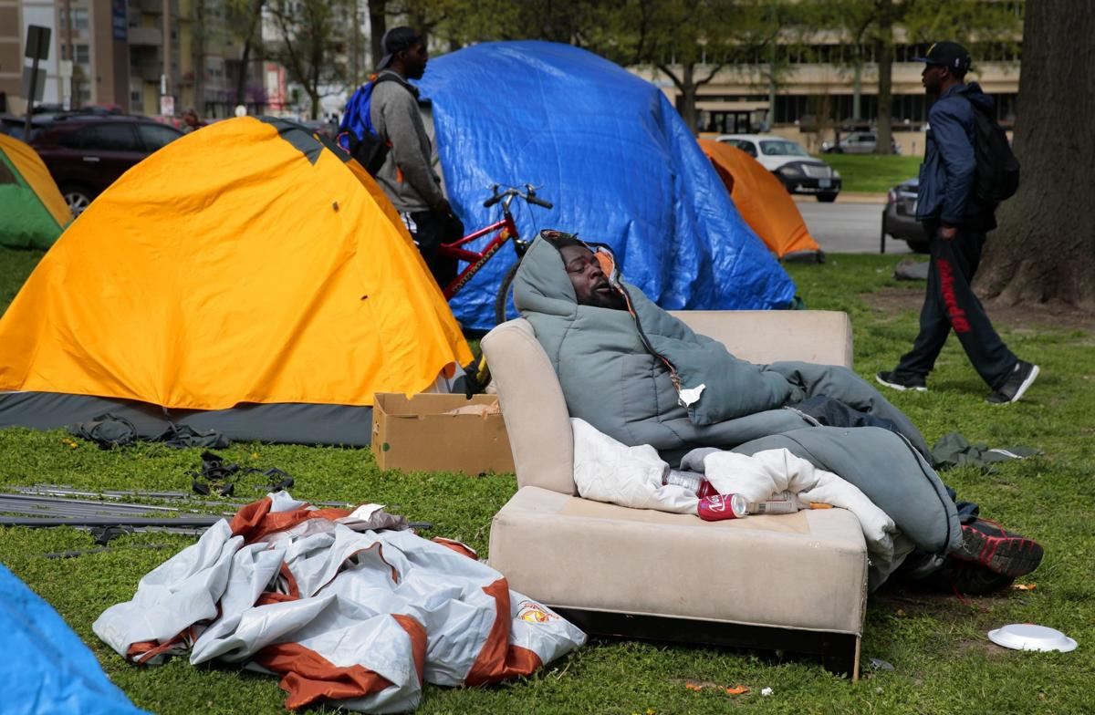 City tries to close downtown homeless camp despite CDC guidelines