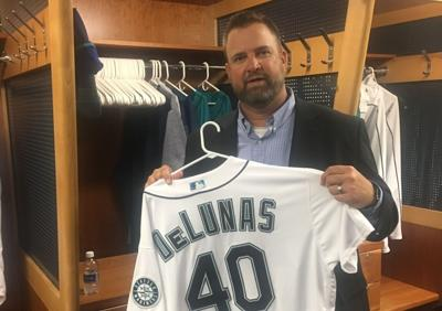 Brian DeLunas holds his Mariners jersey
