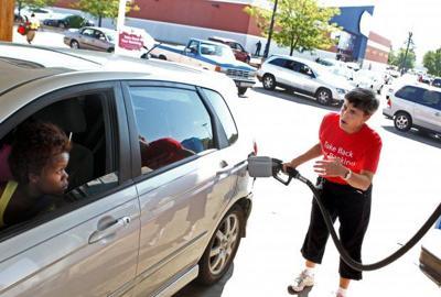 Woman pumps gas in Hazelwood